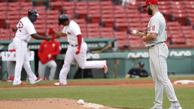Philadelphia's Jake Arrieta walks back to the mound as Boston's Rafael Devers rounds the bases after his two-run home run during the third inning of Wednesday's game.