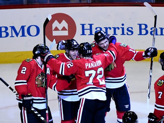 low priced 8365d 29366 Kane helps Blackhawks beat Flames 5-1 for 3rd straight win