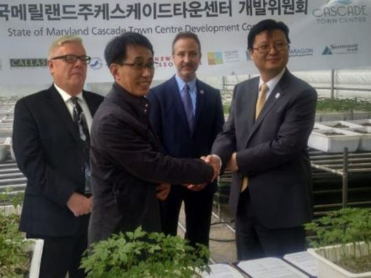 Local and South Korean business officials involved in the Cascade Town Centre project visited the smart farm Korea Ginseng Natural Incorp. in South Korea in March. Pictured are, from left, Gregg Thompson (Brechbill & Helman), Seung Hoon Ryuh (Korea Ginseng Natural Incorp), Andy Shakely (Nutec Group), Wonro Lee (JGBLI)