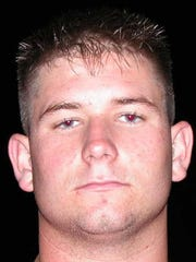 A file photo of Willard Truckenmiller from December 2002 when he was a linebacker at Riverdale High School. He went on to become a Marine and a Lee County sheriff's deputy before he died.