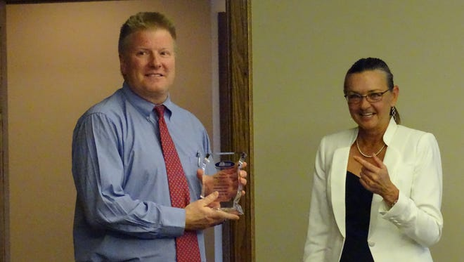 Judge Michael Ater receives the Advocate of the Year award from the Paint Valley Alcohol, Drug Addiction, and Mental Health Services Board's Executive Director Juni Johnson Wednesday night.