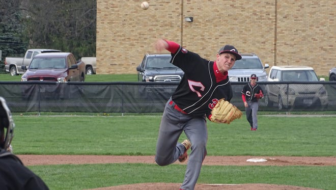 Coshocton's Logan Desender throws a pitch during Thursday's game in Sandyville.