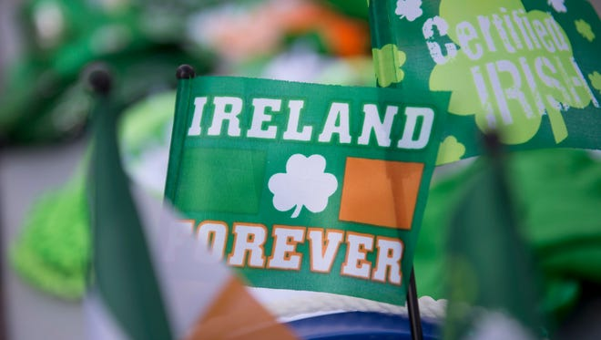 Irish flags and memorabilia for sale decorate a table during Gloucester City's first St. Patrick's Day parade on Monmouth Street on Sunday, March 6, 2016.