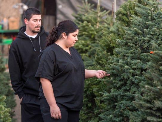 Nadia Lopez and Richard Johnson of Visalia shop Christmas