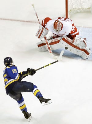 Petr Mrazek stops the Blues' Robby Fabbri during the shootout Thursday night in St. Louis.