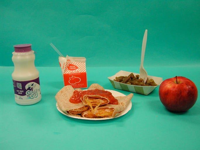 Quesadilla, apple, green beans, apple juice, and milk