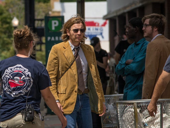 "Actor Ewan McGregor walks across Seventh St. in downtown Cincinnati during the first day of filming for Don Cheadle's ""Miles Ahead."""