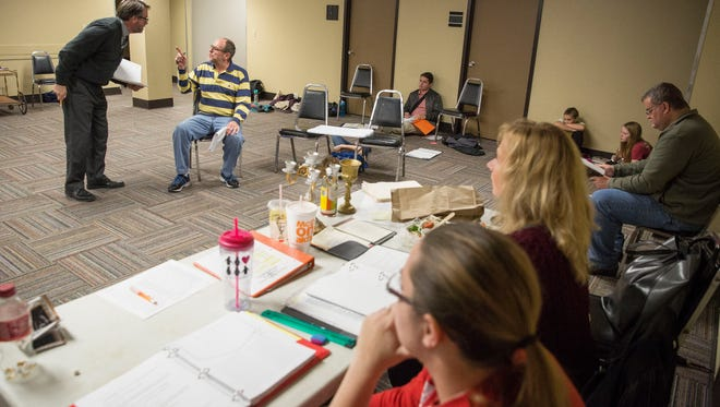 """Actors work on their lines and scenes for """"Scrooge! The Musical"""" on Nov. 14 inside the former WorkOne building in downtown Muncie. Scrooge will open on Dec. 8 in the newly renovated Muncie Civic Theatre."""