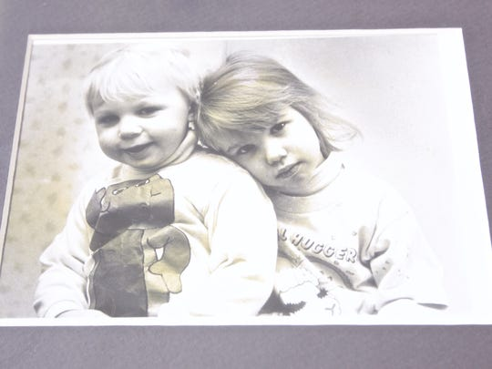 A photo of a childhood picture of Rachel and her sister. Rachel was born as a boy, named Roger.