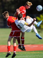 Mater Dei's Zack Welp (6) Mater Dei's Keegan Marx (4) and Providence's Eli Coker (3) go for the ball during their Class A semistate game at Bundrant Stadium in Evansville, Saturday, Oct. 22, 2016. Providence beat Mater Dei 4-0.