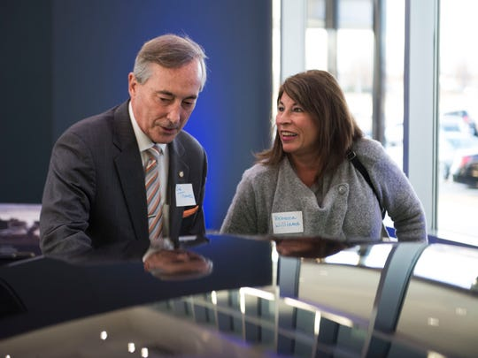 Knox County mayoral candidate Bob Thomas and Rebecca Williams look at a car at a reception celebrating the 75th anniversary of The Boys & Girls Clubs of the Tennessee Valley at Mercedes-Benz Knoxville Wednesday, Jan. 24, 2018.