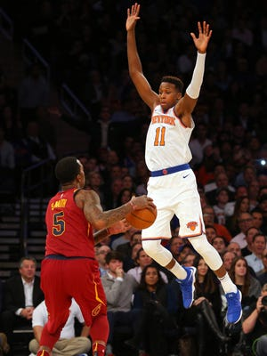 Cleveland Cavaliers shooting guard JR Smith (5) plays the ball against New York Knicks point guard Frank Ntilikina (11) during the fourth quarter at Madison Square Garden on Nov. 13, 2017. Cleveland rallied in this quarter, outscoring the Knicks, 43-25, to win the game, 104-101.