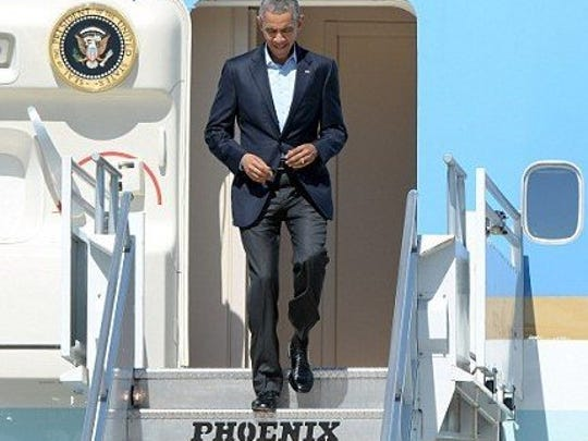 President Barack Obama exits Air Force One on passenger stairs manufactured in Fort Pierce by Phoenix Metal Products.