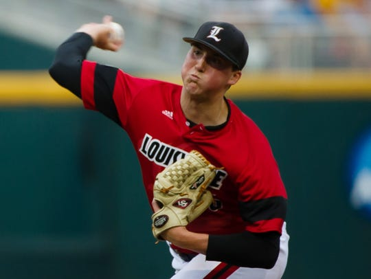 Louisville starting pitcher Kyle Funkhouser throws