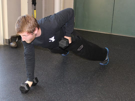 Bend your right elbow and raise the dumbbell until the elbow passes your torso.