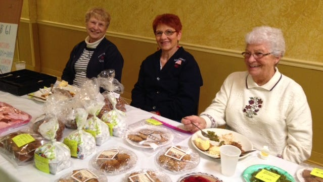 L to R: State past president Carol Wise and members Barbara Williams and Shirley Jordan volunteer at a bake sale.