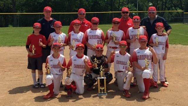The 11U Canton Cardinals celebrate winning the Saline Summer Slam on July 11. The team also recently won the USSSA AA Summer Slam NIT in Shelby Twp.