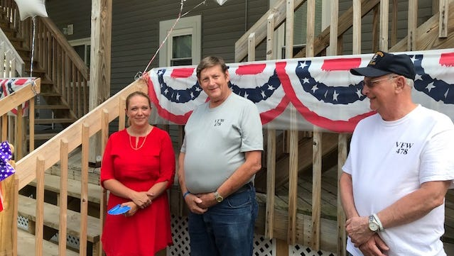 From left, Aliece Tanzini, intensive housing family advocate for the Veterans Housing Project in Binghamton, accepts donated gift cards on behalf of the residents from VFW Post 478 Commander John D. Lauer and Trustee Bill Baumlin on July 3.