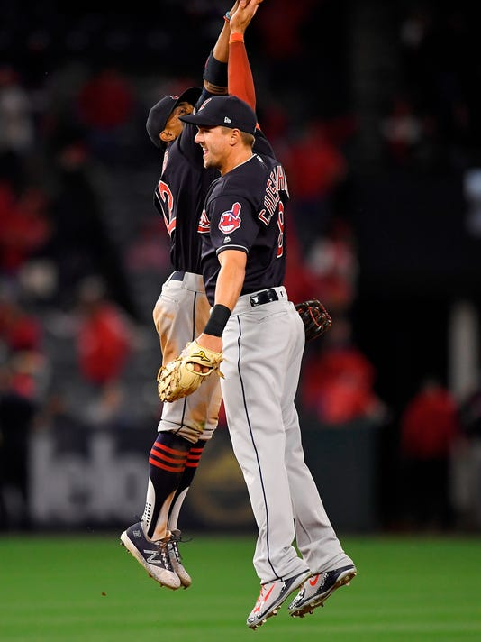 Cleveland Indians shortstop Francisco Lindor, left, and right fielder Lonnie Chisenhall celebrate after the Indians defeated the Los Angeles Angels 6-0 in a baseball game, Monday, April 2, 2018, in Anaheim, Calif. (AP Photo/Mark J. Terrill)