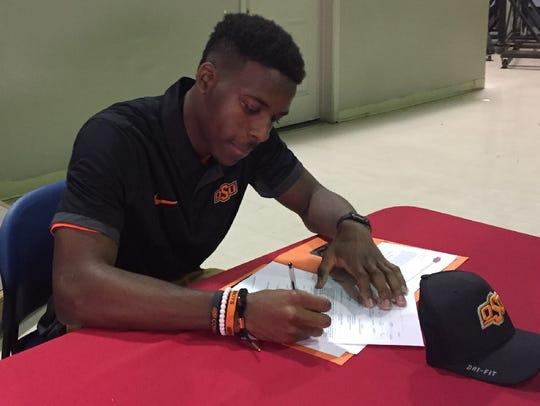 Evangel's Jarrick Bernard signs with Oklahoma State.