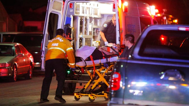 Paramedics respond in November 2014 to a shooting at East Alisal Street and Hebbron Avenue.
