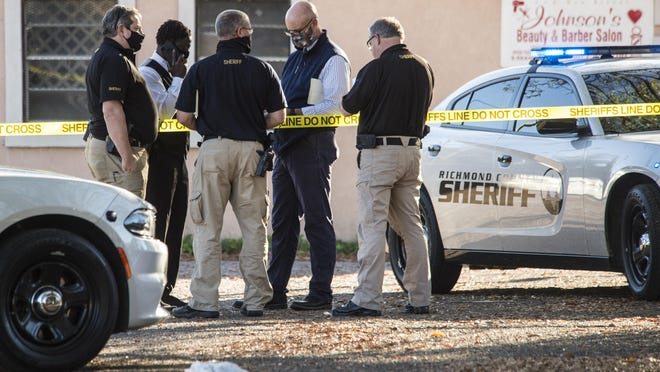 Investigators on the scene of a shooting at a barber shop in the Harrisburg neighborhood in Augusta, Ga., Monday afternoon November 23, 2020.