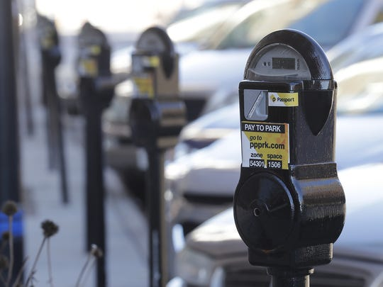 Parking meters on the west side of the 100 block of Washington Street in Green Bay.
