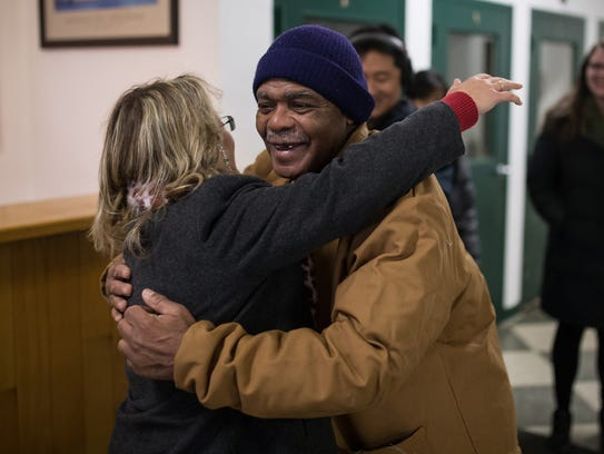 John Sam Hall, 67, formerly of Detroit hugs his lawyer