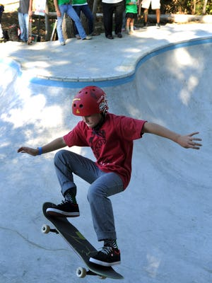 "Twelve-year-old Caleb Myers, of Ocean Pines, goes airborne during skating run at Epworth Skate Park Saturday during the ""Skate, Don't Hate"" event."