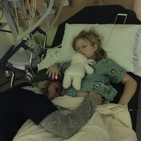 Natalie Grant and her husband, Bernie Herms, in a Facebook pic posted Dec. 29 in a pediatric ICU where their daughter, Gracie, was battling severe asthma complications