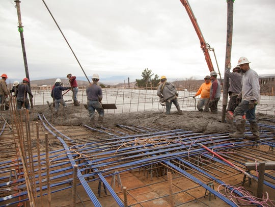 With the use of three concrete pumps crews pour the
