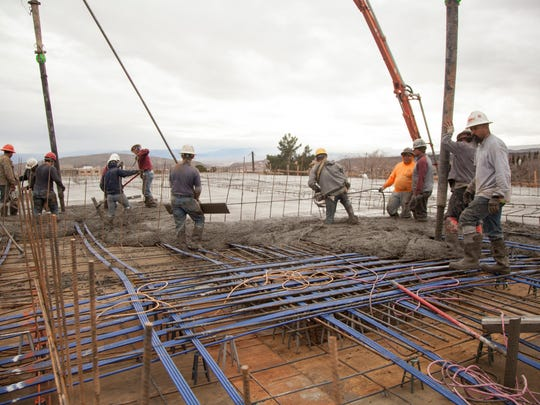 With the use of three concrete pumps crews pour the first floor of the new, 265-bed student housing community, Vintage at Tabernacle, Saturday, Feb. 11, 2017.