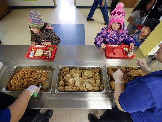 Elementary school students pick from two entrees at