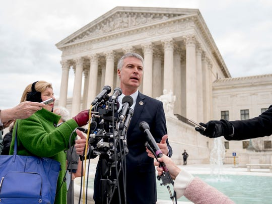 South Dakota Attorney General Marty Jackley speaks outside the Supreme Court after arguing that the justices should let states collect sales taxes from most online retailers.