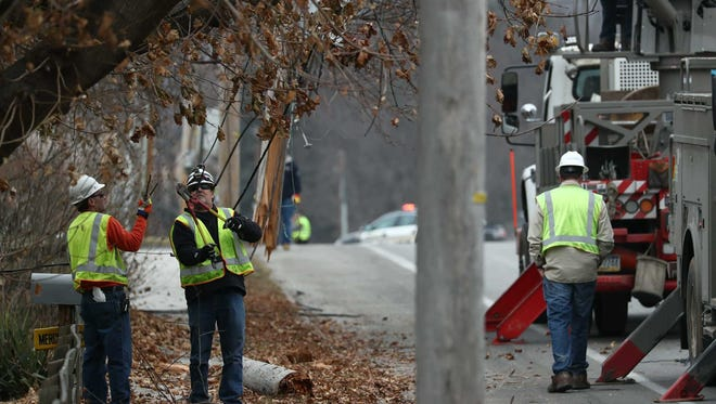 Crews work to repair an electrical pole after a car crash on Broadway on Thursday.
