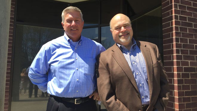 Adams Radio Group President and CEO Ron Stone, left, is shown with Market Manager Phil Locascio outside of the location where Adams Radio Group will be moving to in the NorthGate Business Park off Naylor Mill Road in Salisbury.