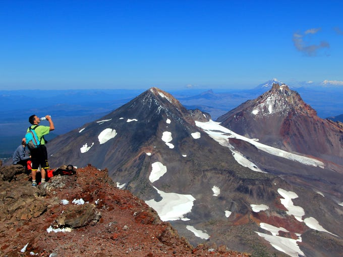 The view from the summit of South Sister, Oregon's third tallest mountain, offers an incredible view of Middle and North Sister immediately to the north.