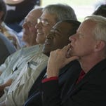 Larimer County Commissioners Lew Gaiter III and Steve Johnson listen as U.S. Sen. Cory Gardner speaks in favor of the Northern Integrated Supply Project during a support rally this summer at Northern Water in Berthoud.