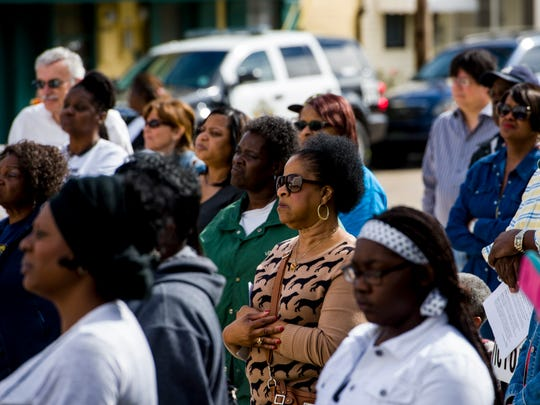 Residents listen to speeches during a rally for Victor White III at the Iberia Parish Courthouse in New Iberia.