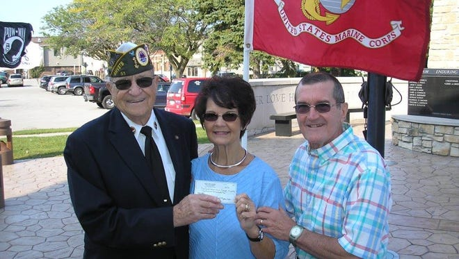 Joe Heilman, left, chairman of the Door County Veterans Service Council, accepts a donation from Phyllis and Scott Chobot designated to help local veterans. The check is the couple's sixth donation to mark 9/11 on Monday, Sept. 11, 2017.