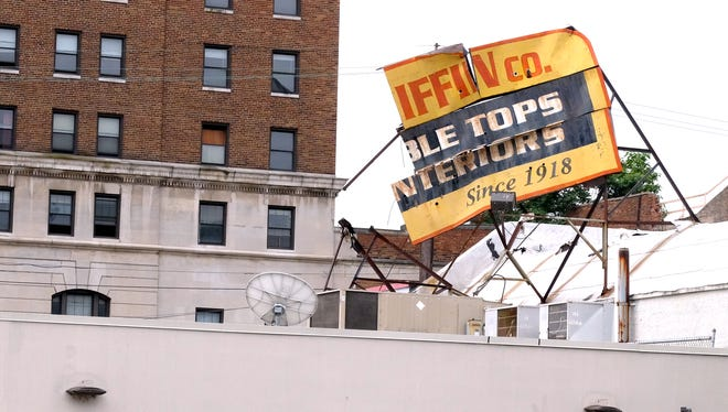 The Fisher-Griffin Co. in Walnut Hills lost a 75-year-old sign to a storm on Thursday, May 31, 2018. The business will celebrate its 100th anniversary this year.