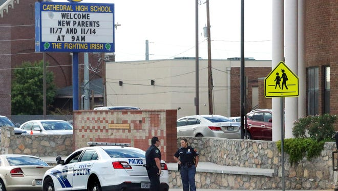 El Paso and El Paso Community College police officers position themselves at the entrance to Cathedral High School Wednesday.