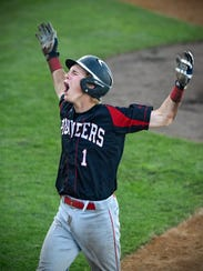 Matthew Tautges celebrates after crossing home plate
