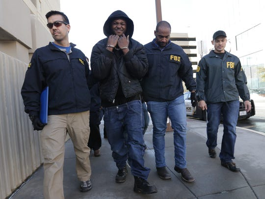 FBI top ten most wanted Terry A.D. Strickland was captured in El Paso. Above, Strickland is walked into the El Paso County jail escorted by the FBI agents who captured him.