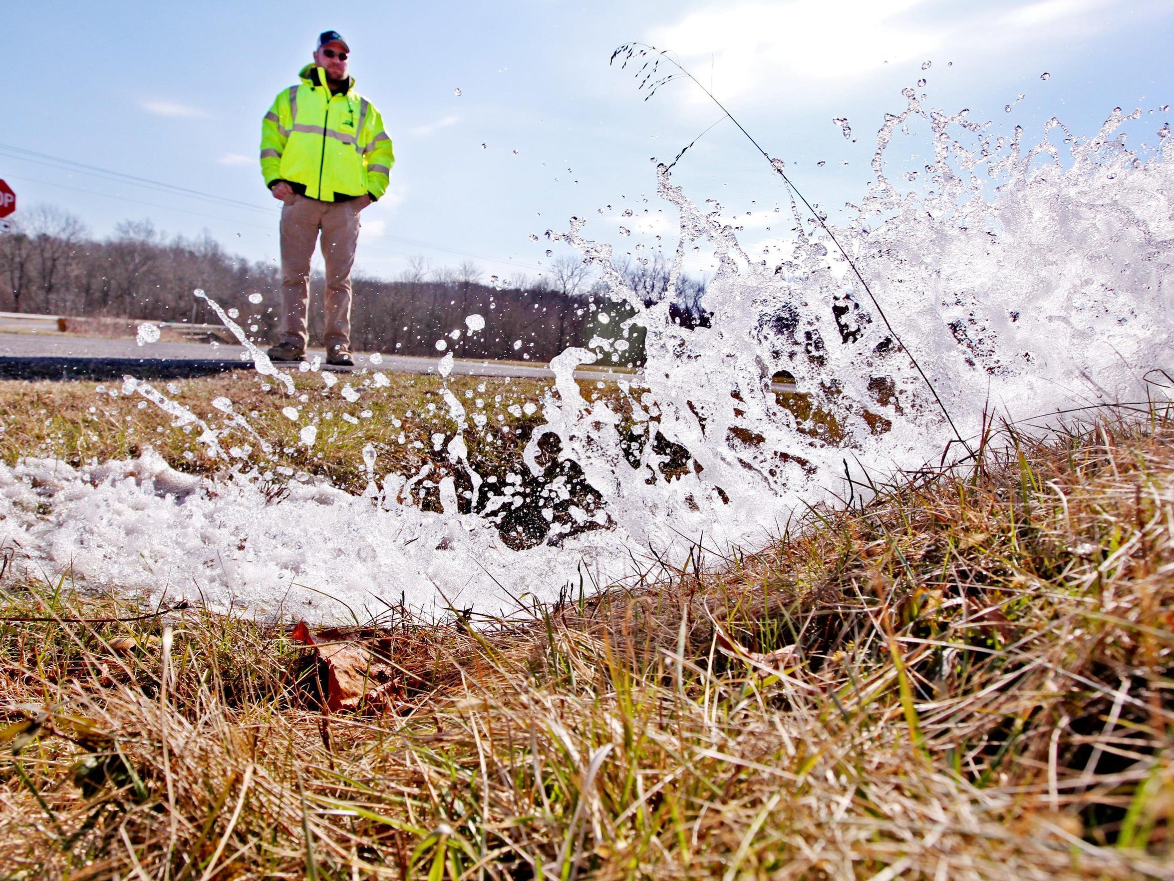 Chad Hammer, Collection and Distribution Supervisor for the Augusta County Service Authority, watches as water gushes out of a waterline that was scheduled for a routine chlorine level check on Thursday, March 3, 2016 just east of Verona. The hydrant marks the end of a waterline that reaches a couple miles outside of Verona on Laurel Hill Road.