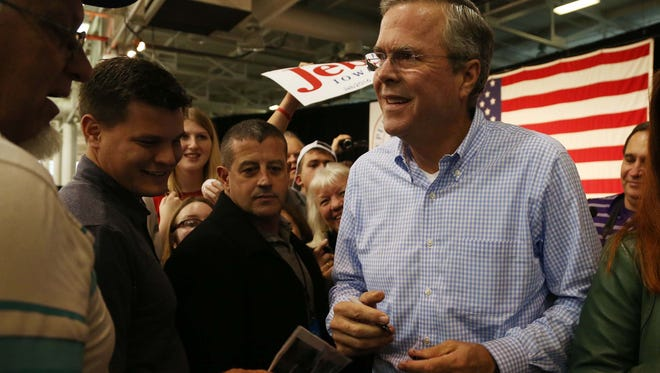 Presidential hopeful Jeb Bush makes his way through the crowd during the Growth and Opportunity Party on Saturday, Oct. 31, 2015 at the Varied Industries Building in Des Moines.