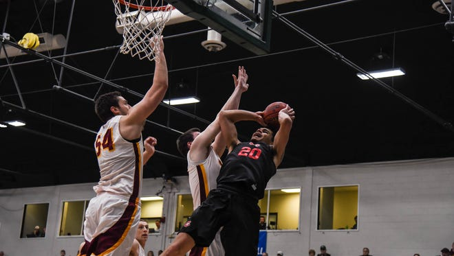 St. Cloud State's Gage Davis battles near the basket in Sunday's game against Northern State.