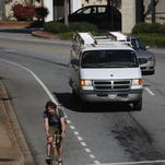 Bicyclists ride in downtown Greenville on Wednesday afternoon, taking advantage of bike lanes and cross walks.
