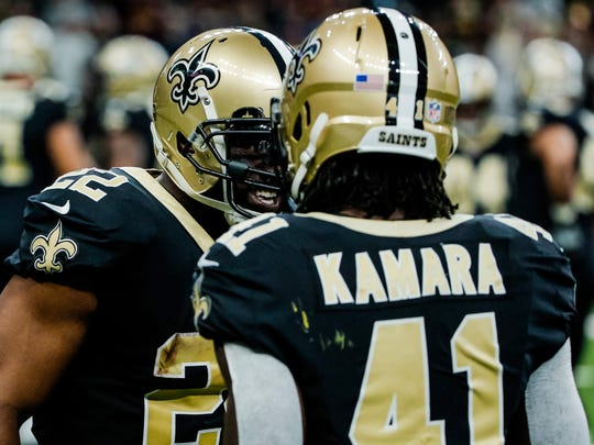 New Orleans Saints running back Mark Ingram  celebrates after a touchdown with running back Alvin Kamara during the first quarter of a game against the Washington Redskins at the Mercedes-Benz Superdome.