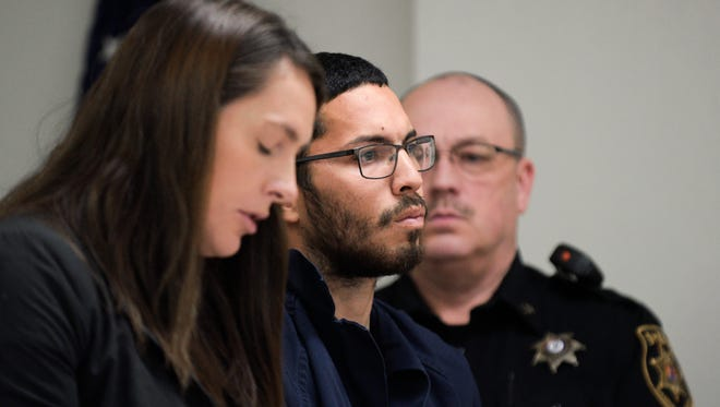 Raul 'Omar' Quinones of Camden, center, appears in court for a pre-trial detention hearing Thursday, March 29, 2018 at the Camden County Hall of Justice in Camden, N.J. Quinones is charged with a double stabbing that left his estranged girlfriend dead and her son in critical condition.